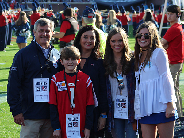 Felton Walker, wearing jersey No. 1, was the Children's of Mississippi Kid Captain during the Egg Bowl in Oxford. The Kid Captain Program honors pediatric patients and celebrates their inspiring stories. Also on the field for the ceremony are, from left, Chip Walker, Liz Walker, and Felton's sisters Mary Faser and Elizabeth.